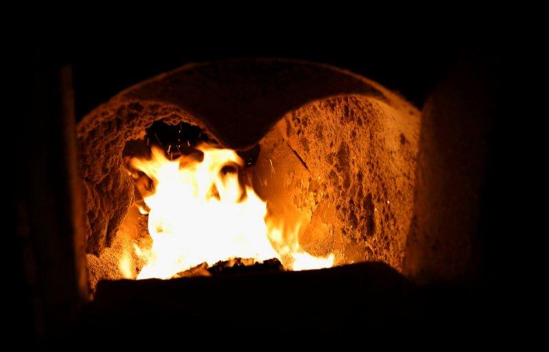 Zieuwent,  Tim Krabben kraamstal  met biomassagaskachel verwarminginstallatie. fotografie Hans Prinsen